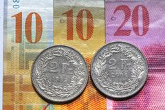 Swiss Frank Bills and coins stock images