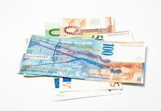 Swiss franks and euro. Swiss frank banknotes laying over euro Royalty Free Stock Image