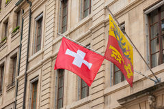 Swiss and Geneva flag floating Royalty Free Stock Photos