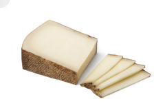 Swiss Gruyere cheese ans slices Royalty Free Stock Photography