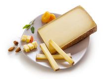 Swiss Gruyere cheese in a plate Royalty Free Stock Image