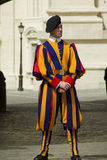Swiss guard outside Vatican. Vatican City State - April 29, 2013; Pontifical Swiss guard dressed in the renaisance style uniform on duty outside the Vatican Royalty Free Stock Images