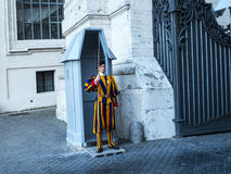 Swiss Guard of the Papal Basilica of St. Peter in Vatican City. Designed principally by Donato Bramante, Michelangelo, Carlo Maderno and Gian Lorenzo Bernini, St royalty free stock photo