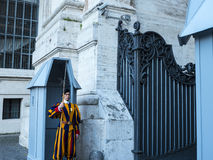 Swiss Guard of the Papal Basilica of St. Peter in Vatican City. Designed principally by Donato Bramante, Michelangelo, Carlo Maderno and Gian Lorenzo Bernini, St Royalty Free Stock Image