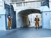 Swiss Guard of the Papal Basilica of St. Peter in Vatican City. Designed principally by Donato Bramante, Michelangelo, Carlo Maderno and Gian Lorenzo Bernini, St stock image