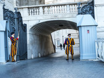 Swiss Guard of the Papal Basilica of St. Peter in Vatican City. Designed principally by Donato Bramante, Michelangelo, Carlo Maderno and Gian Lorenzo Bernini, St stock photos