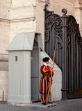 Swiss Guard soldier in Vatican City. Member of the Pontifical Swiss Guard standing guard in Saint Peter Square stock image