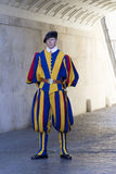 Swiss Guard of Vatican City. Swiss guard standing in front of the entrance of the Vatican City royalty free stock image