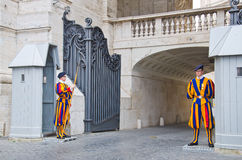 Swiss guards. VATICAN CITY, ITALY - March 23: A pair of Papal Swiss guards stand guard at the entrance of Saint Peter's Basilica on March 23, 2012. Swiss Guards stock image