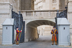 Swiss guards. VATICAN CITY, ITALY - March 23: A pair of Papal Swiss guards stand guard at the entrance of Saint Peter's Basilica on March 23, 2012. Swiss Guards royalty free stock photo