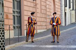 Swiss guards at the entrance of the Vatican. Uniformed swiss guards at the entrance of the Vatican stock photography