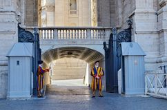 Swiss Guards guard the Gate of St. Peter`s Basilica in Vatican State City. Vatican City, Rome, Italy, September 12, 2015: Swiss Guards guard the Gate of St royalty free stock image