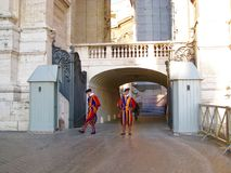 Swiss Guards guarding the entrance to Vatican. Swiss Guards are the Swiss soldiers who have served as guards at foreign European courts since the late 15th stock photo