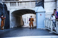 Swiss Guards in the Piazza St Pietro by St Peter`s Basilica in the Vatican City in Rome Italy. Rome Italy, the Eternal city, which has been a destination for stock images