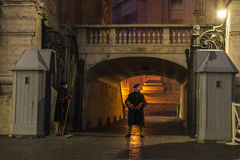Swiss Guards posted at night in Vatican City. Vatican City, Vatican - January 4, 2017: Swiss Guards posted at night at St. Peter`s Basilica in Vatican City in stock photos