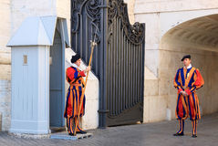 Swiss guards near St. Peters Basilica in Rome, Italy. Swiss Guards are the Swiss soldiers who have served as bodyguards and ceremonial guards since the late 15th Stock Photo
