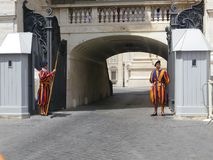 Swiss Guards in Uniform Outside of Tunnel at St. Peter`s Basilica royalty free stock photography
