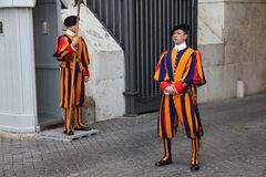 Swiss Guards in Vatican. ROME - APRIL 9: Swiss Guards stand in front of Saint Peter's Basilica on April 9, 2012 in Rome. The Papal Swiss Guard was founded in royalty free stock photos