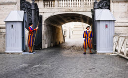 Swiss Guards of Vatican City. The swiss guards at the entrance of St. Peters Basilica in Vatican City in Rome (Italy stock photography