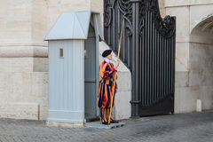 Swiss guards. VATICAN CITY, VATICAN - SEPTEMBER 26: Papal Swiss guards stand guard at the entrance of Saint Peter's Basilica on September 26, 2012. Swiss Guards royalty free stock image
