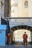 Swiss guards. VATICAN CITY, VATICAN - SEPTEMBER 26: Papal Swiss guards stand guard at the entrance of Saint Peter's Basilica on September 26, 2012. Swiss Guards royalty free stock photos