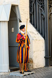 The Swiss Guards of Vatican, Italy. VATICAN CITY, ITALY - SEPTEMBER 15, 2011: A Papal Swiss Guard stay guarding at the entrance of Saint Peter's Basilica on stock photography