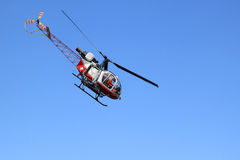 Swiss helicopter is flying in the Bernese Oberland Royalty Free Stock Image