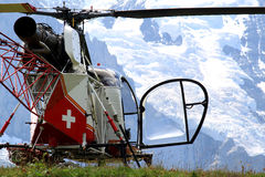 Swiss helicopter in the mounts of Bernese Oberland. Swiss helicopter has been landed upon the Kleine Scheidegg, the pass between the Lauterbrunnen and Royalty Free Stock Photo