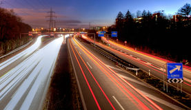 Swiss Highway At Dusk. Swiss highway to France near Geneva, Switzerland at dusk with light trails Royalty Free Stock Photography