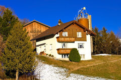 Swiss house. Typical swiss farm house in winter field Stock Photo