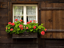 Swiss House with Flowerbox in Window Royalty Free Stock Photography