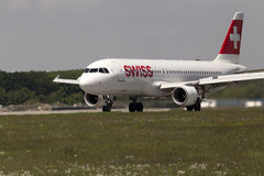 Swiss International AirLines Airbus A320-214 aircraft landing on the runway Royalty Free Stock Image