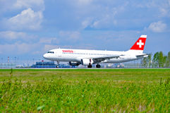 Swiss International Airlines Airbus A320 airplane rides on the runway after arrival in Pulkovo International airport in royalty free stock image