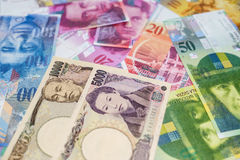 Swiss and Japanese currency Royalty Free Stock Photos