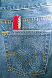 Swiss knife in back pocket of jeans Stock Image