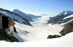Swiss Konkordiaplatz, part of the Aletsch Glacier. The Konkordiaplatz (2799 m) and the mountain ridges of the high snow-covered peaks of the Alps in the middle royalty free stock photography