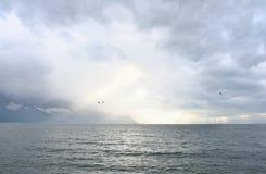 Swiss lake Leman. Sunny stormy sky over swiss lake Leman stock photography