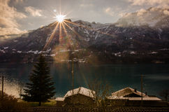 Swiss lake shore sunrise. Morning view from shore of Brienzersee Stock Images