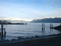 Swiss Lake snow on mountains. Lake Lausanne Switzerland snow on Mountains royalty free stock photo