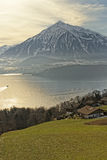 Swiss lake view near Thun with a view of Niesen peak and a small Royalty Free Stock Photography