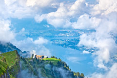 Swiss landscape through clouds Royalty Free Stock Photography