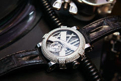 Swiss luxury watch with diamonds on the table Royalty Free Stock Images