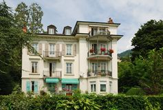 Swiss mansion in the middle of verdure. Stock Images
