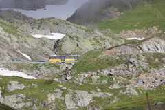 Swiss Mountain with bus. Swiss mountain with yellow bus Royalty Free Stock Photo