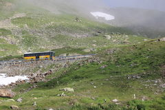 Swiss Mountain with bus. Swiss mountain with yellow bus Royalty Free Stock Image