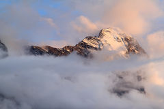 The Swiss mountain Eiger in clouds and evening sun Stock Images