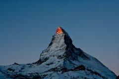 Swiss Mountain Peak. Dawn light hitting the peak of the Matterhorn in the Pennine Alps in Switzerland Royalty Free Stock Photos