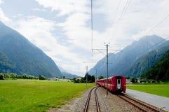 Swiss mountain train Bernina Express crossed through the high mo Stock Photo