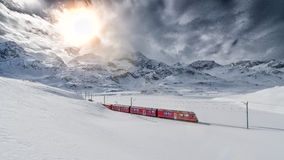Swiss mountain train Bernina Express crossed through the high mo royalty free stock photos