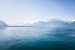 Swiss mountains. French and Swiss Alps at the end of lake Geneva during summer but still covered in snow Royalty Free Stock Photos